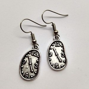 5/$20 Cute melty clocks stretched earrings